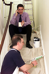 Time Energy Network Ltd. Andrew Long, Managing Director with painter and decorator Seamus Me, UK, April 19, 2000. Photo by Andrew Parsons / i-images..