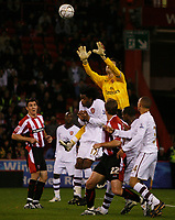 Photo: Steve Bond.<br />Sheffield United v Arsenal. Carling Cup. 31/10/2007. Keeper Lukasz Fabianski safely gathers a cross
