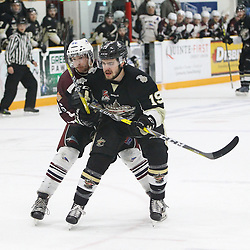 TRENTON, ON  - MAY 4,  2017: Canadian Junior Hockey League, Central Canadian Jr. &quot;A&quot; Championship. The Dudley Hewitt Cup. Game 6 between Trenton Golden Hawks and the Dryden GM Ice Dogs Ben Scheel #19 of the Trenton Golden Hawks and  Braeden Allkins #16 of the Dryden GM Ice Dogs battle for position during the second period.<br /> (Photo by Tim Bates / OJHL Images)