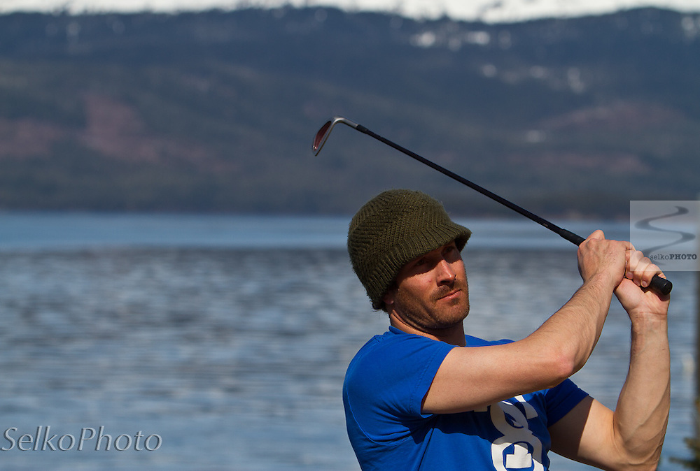 Seth Wescott practicing golf at Points North Heli Skiing in front of the Orca Lodge in Cordova,AK on April 18, 2011.