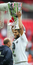 LONDON, ENGLAND - Saturday, May 30, 2011: Swansea City's Ashley Williams celebrates with the trophy after beating Reading 4-2 during the Football League Championship Play-Off Final match at Wembley Stadium. (Photo by David Rawcliffe/Propaganda)