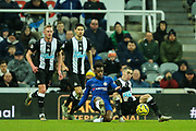 Callum Hudson-Odoi (#20) of Chelsea and Miguel Almiron (#24) of Newcastle United slide in to win the ball during the Premier League match between Newcastle United and Chelsea at St. James's Park, Newcastle, England on 18 January 2020.