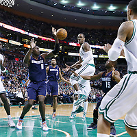 14 January 2013: Boston Celtics point guard Rajon Rondo (9) passes the ball to Boston Celtics shooting guard Courtney Lee (11) during the Boston Celtics 100-89 victory over the Charlotte Bobcats at the TD Garden, Boston, Massachusetts, USA.
