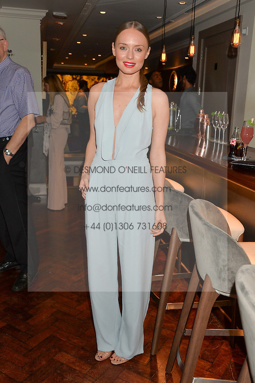 LAURA HADDOCK at a dinner to celebrate 20 years of Maria Grachvogel's fashion label held at Salmontini, 1 Pont Street, London on 22nd October 2014.
