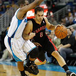 January 17, 2011; New Orleans, LA, USA; Toronto Raptors point guard Jose Calderon (8) drives past New Orleans Hornets point guard Chris Paul (3) during the third quarter at the New Orleans Arena. The Hornets defeated the Raptors 85-81.  Mandatory Credit: Derick E. Hingle