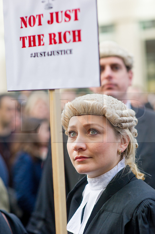 © Licensed to London News Pictures. 07/03/2014. Westminster, London, UK. A barrister protests outside the Ministry of Justice as part of the Save UK Justice campaign against legal aid cuts. Photo credit : David Tett/LNP