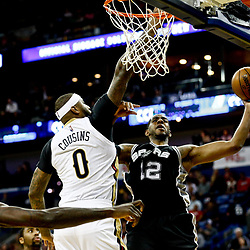 Mar 3, 2017; New Orleans, LA, USA; San Antonio Spurs forward LaMarcus Aldridge (12) shoots over New Orleans Pelicans forward DeMarcus Cousins (0) during the second half of a game at the Smoothie King Center. The Spurs defeated the Pelicans 101-98 in overtime. Mandatory Credit: Derick E. Hingle-USA TODAY Sports