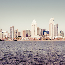 San Diego skyline retro panorama picture with downtown San Diego city buildings and skyscrapers. Panoramic photo ratio is 1:3 and has a vintage nostalgic tone. San Diego is a major city in Southern California in the United States.
