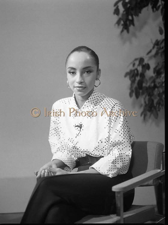 "Sade and Tony Hadley Interviews.  P92..1984.21.08.1984..08.21.1984..21st August 1984..As part of his interview sessions for ""Video File"" for R.T.E., Marty Whelan interviewed international music stars. The interviews were held in the R.T.E.,studios and at various hotels throughout the city...Singer, Sade, is pictured prior to her interview with Marty Whelan for R.T.E.s Video File."