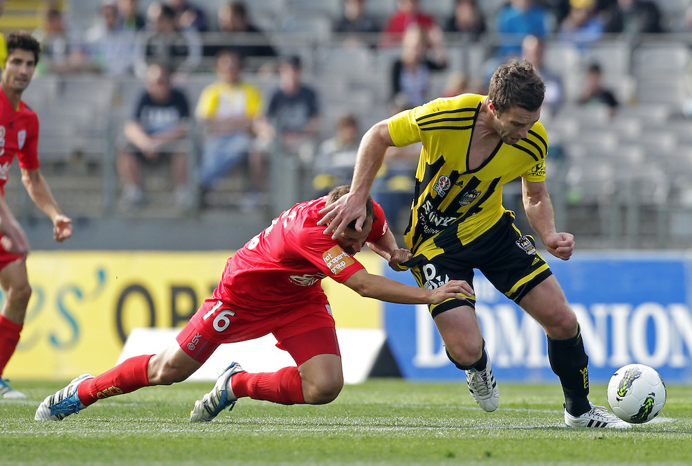 Wellington Phoenix's Tim Brown is brough down by Adelaide United's Spase Dilevski in the Hyundri football A-league match, Eden Park, Auckland, New Zealand, Saturday, November 19, 2011.  Credit:SNPA / David Rowland