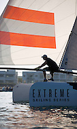 The Extreme Sailing Series 2013. Act 1. <br /> <br /> Showing Red Bull Racing, skippered by Roman Hagara (AUT) with tactician Hans Peter Steinacher (AUT), mainsail trim Matthew Adams (GBR), headsail trim Pierre Le Clainche (FRA) and bowman Graeme Spence (AUS)<br /> <br /> Muscat. Oman<br /> Please credit: Lloyd Images