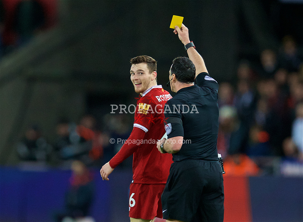 SWANSEA, WALES - Monday, January 22, 2018: Liverpool's Andy Robertson is shown a yellow card by referee Neil Swarbrick during the FA Premier League match between Swansea City FC and Liverpool FC at the Liberty Stadium. (Pic by David Rawcliffe/Propaganda)