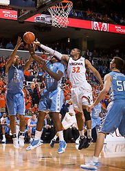 North Carolina forward Deon Thompson (21) grabs a rebound from Virginia forward Mike Scott (32).  The the #5 ranked North Carolina Tar Heels defeated the Virginia Cavaliers 83-61 in NCAA Basketball at the John Paul Jones Arena on the Grounds of the University of Virginia in Charlottesville, VA on January 15, 2009.