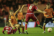 Björn Sigurðarson (Wolverhampton Wanderers) is tackled by Adam Clayton (Middlesbrough) as the ball goes past Ben Gibson (Middlesbrough) during the Sky Bet Championship match between Middlesbrough and Wolverhampton Wanderers at the Riverside Stadium, Middlesbrough, England on 4 March 2016. Photo by Mark P Doherty.