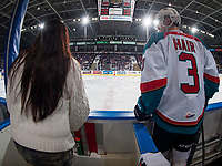 KELOWNA, CANADA - FEBRUARY 17: Kelvin Hair #3 of the Kelowna Rockets stands on the bench next to team photographer Marissa Baecker against the Edmonton Oil Kings on February 17, 2018 at Prospera Place in Kelowna, British Columbia, Canada.  (Photo by Marissa Baecker/Shoot the Breeze)  *** Local Caption ***