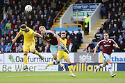Burnley midfielder Scott Arfield (37)  flicks the ball on  during the Sky Bet Championship match between Burnley and Leeds United at Turf Moor, Burnley, England on 9 April 2016. Photo by Simon Davies.
