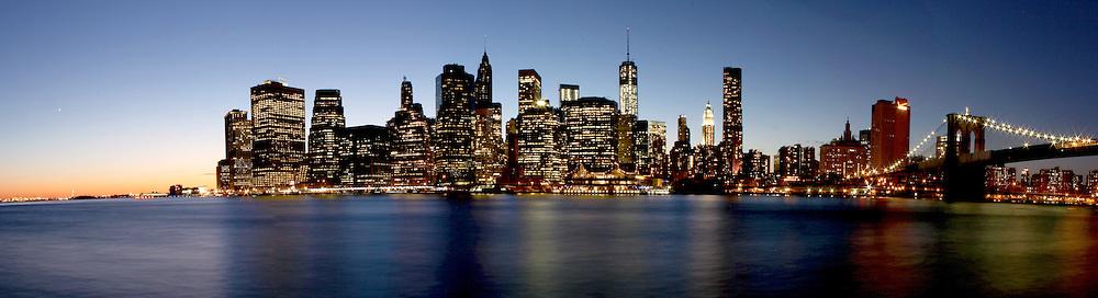 Twilight as the sun sets over Lower Manhattan. Famous New York landmarks