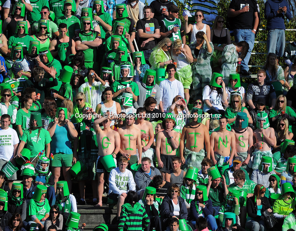 Barechested Callum Gibbins fans in the Bucket Zone. ITM Cup rugby - Manawatu Turbos v Wellington Lions at FMG Stadium, Palmerston North, New Zealand on Saturday, 4 September 2010. Photo: Dave Lintott/Photosport