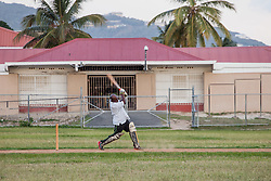 Everad Fregiste takes a swing.  Players of the 40 and over cricket team practice for an upcoming tournament at Addelita Cancryn field.  St. Thomas, USVI.  14 April 2015.  © Aisha-Zakiya Boyd
