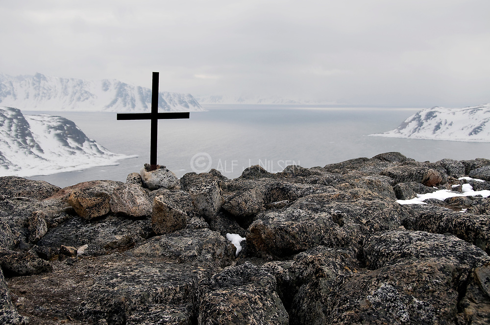 A lonely cross at the top of Norsköya at 79 degrees north situated on the north-western corner of Spitsbergen, Svalbard.  Noone knows who raised the old cross.