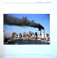 The World Trade Center building burn after being struck by airplanes on September 11, 2001. The towers collapsed moments later.