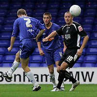 Photo: Dave Howarth.<br />Stockport County v Swansea City. The FA Cup.<br />05/11/2005.  Swansea's Lee Trundle (R) watches the ball sail golwards but to no avail