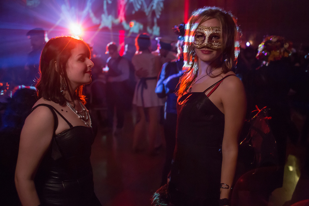 Two women caught in the lights.