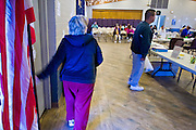 08 DECEMBER 2010 - PHOENIX, AZ: Patients walk into a Mission of Mercy mobile clinic in Phoenix, AZ, Wednesday, Dec. 8. Mission of Mercy has been providing free medical help for people in the Phoenix area since 1997. In the last two years, as the Arizona economy continued its recessionary slide, patient load at the clinics has more than doubled. Mission of Mercy, which relies on voluntary medical help and financial donations, recently acquired another mobile clinic so they could expand their reach into suburban areas they previously had not served. Mission of Mercy has provided free medical help to more than 43,000 patients in the Phoenix area since 1997.    PHOTO BY JACK KURTZ