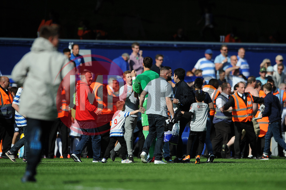 QPR fans invade the pitch at full time - Photo mandatory by-line: Dougie Allward/JMP - Mobile: 07966 386802 - 16/05/2015 - SPORT - football - London - Loftus Road - QPR v Newcastle United - Barclays Premier League