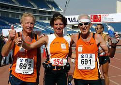 21-10-2007 ATLETIEK: ANA BEIJING MARATHON: BEIJING CHINA<br /> De Beijing Olympic Marathon Experience georganiseerd door NOC NSF en ATP is een groot succes geworden / Minister Gerda Verburg, 692 en 691<br /> ©2007-WWW.FOTOHOOGENDOORN.NL