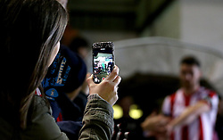 A Lincoln City fan films the teams coming out on her phone ahead of the FA Cup third round replay against Ipswich Town - Mandatory by-line: Robbie Stephenson/JMP - 17/01/2017 - FOOTBALL - Sincil Bank Stadium - Lincoln, England - Lincoln City v Ipswich Town - Emirates FA Cup third round replay