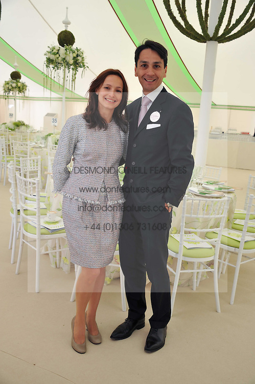 FRANCOIS &  LIUDMILA LE TROQUER at the 27th annual Cartier International Polo Day featuring the 100th Coronation Cup between England and Brazil held at Guards Polo Club, Windsor Great Park, Berkshire on 24th July 2011.