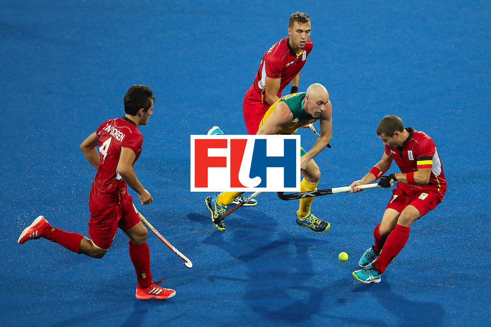 RIO DE JANEIRO, BRAZIL - AUGUST 09:  Glenn Turner #4 of Australia pushes the ball past John-John Dohmen #7 of Belgium during the hockey game on Day 4 of the Rio 2016 Olympic Games at the Olympic Hockey Centre on August 9, 2016 in Rio de Janeiro, Brazil.  (Photo by Christian Petersen/Getty Images)