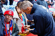 Picture by David Horn/Focus Images Ltd +44 7545 970036<br /> 09/11/2013<br /> Keith Millen , Caretaker Manager of Crystal Palace signs autographs before what could be his last game in charge before the Barclays Premier League match at Selhurst Park, London.