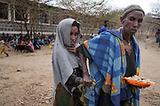 Tartuarwa, Ethiopia - 17.05.16  - A blind community member is also allowed to eat at Tartuarwa primary school in the district of East Belessa, Ethiopia on May 17, 2016. Students -- and impaired community members -- receive a daily meal and water thanks to a CBM-funded inclusive school feeding and water distribution program. Photo by Daniel Hayduk