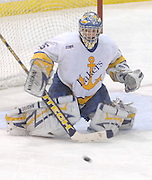 LSSU goaltender Brian Mahoney-Wilson watches a deflected shot go wide Saturday at Taffy Abel Arena in Sault Ste. Marie.