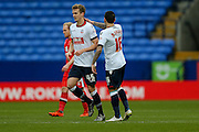 Bolton Wanderers midfielder Mark Davies  congratulates Bolton Wanderers defender Robert Holding on his goal  during the Sky Bet Championship match between Bolton Wanderers and Milton Keynes Dons at the Macron Stadium, Bolton, England on 23 January 2016. Photo by Simon Davies.