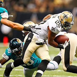 August 17, 2012; New Orleans, LA, USA; New Orleans Saints running back Mark Ingram (28) breaks a tackle attempt by Jacksonville Jaguars linebacker Russell Allen (50)during the first quarter of a preseason game at the Mercedes-Benz Superdome. Mandatory Credit: Derick E. Hingle-US PRESSWIRE