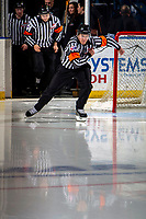 KELOWNA, BC - NOVEMBER 26: Referee Mike Campbell enters the ice to start third period at the Kelowna Rockets against the Edmonton Oil Kings at Prospera Place on November 26, 2019 in Kelowna, Canada. (Photo by Marissa Baecker/Shoot the Breeze)