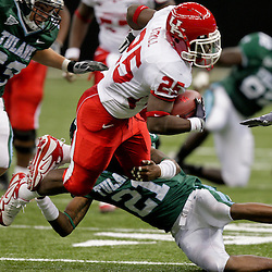 Oct 17, 2009; New Orleans, LA, USA;  Houston Cougars safety Jeremy Smith (25) is tackled by Tulane Green Wave cornerback Charles Harris (21) during the first half at the Louisiana Superdome. Mandatory Credit: Derick E. Hingle-US PRESSWIRE