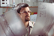 (1992) At the Max Planck Institute of Psychiatry in Munich, Germany, Professor J. T. Epplen looks at DNA gel sequences of D-related B Genes (autoradiograms). DNA consists of two sugar- phosphate backbones, arranged in a double helix, linked by nucleotide bases. There are 4 types of base; adenine (A), cytosine (C), guanine (G) and thymine (T). Sequences of these bases make up genes, which encode an organism's genetic information. The bands (black) on the autoradiogram show the sequence of bases in a sample of DNA. DNA Fingerprinting. MODEL RELEASED