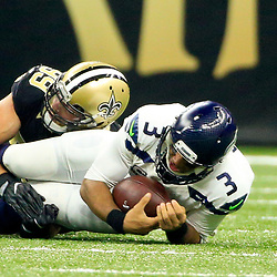 Oct 30, 2016; New Orleans, LA, USA; New Orleans Saints defensive end Paul Kruger (99) sacks Seattle Seahawks quarterback Russell Wilson (3) during the first quarter of a game at the Mercedes-Benz Superdome. Mandatory Credit: Derick E. Hingle-USA TODAY Sports