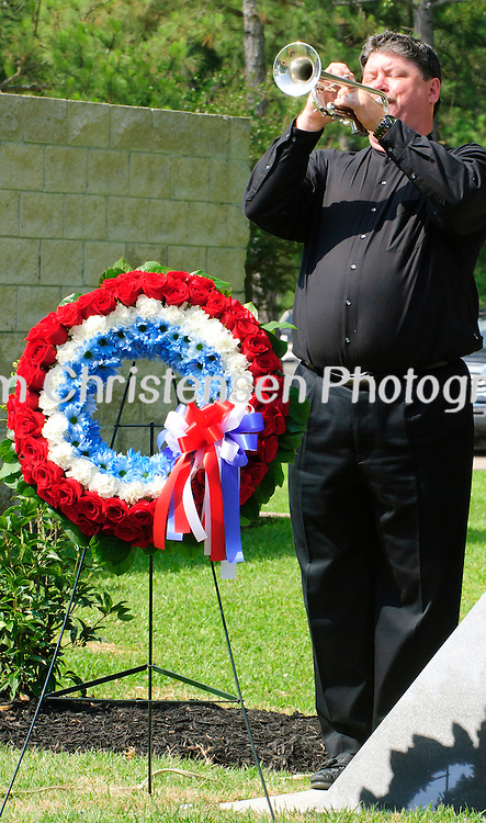 Principal Trumpet from the Clear Lake Symphony Kevin Henderson plays Taps at the closing of the dedication of the new Friendswood Veterans Memorial that was dedicated today.