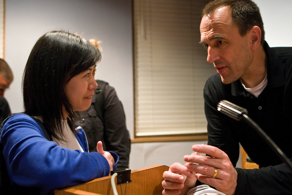 "(from right) After giving a lecture, Jeff Goodell, investigative journalist and author of ""Big Coal,"" speaks with journalism graduate student, Chong Wu of China on Wednesday, April 16, 2008 in Ohio University's Scripps Auditorium."