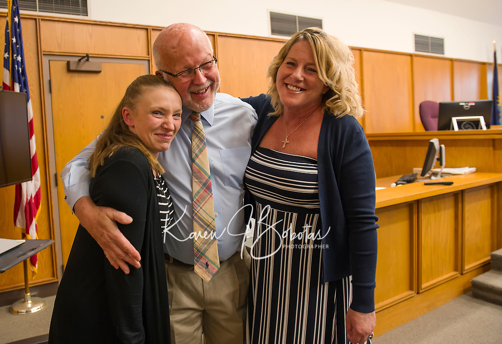 Judge James Carroll steps down from the bench to congratulate Angela Linteau and Julie Moulton following their Recovery Court graduation at Belknap County Superior Court on Tuesday afternoon.  (Karen Bobotas/for the Laconia Daily Sun)