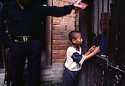 Central Jail Kathmandu, Nepal. Boy visiting his father in Kathmandu main jail. The boy was until early June a resident in the jail because there was no social services to care for him that he was jailed with his father.<br />