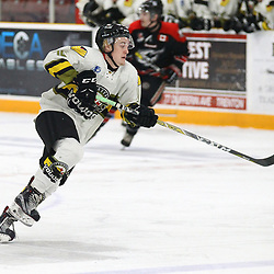 """TRENTON, ON  - MAY 5,  2017: Canadian Junior Hockey League, Central Canadian Jr. """"A"""" Championship. The Dudley Hewitt Cup Game 7 between Georgetown Raiders and the Powassan Voodoos.    Rhys Brown #16 of the Powassan Voodoos skates with the puck during the first period<br /> (Photo by Alex D'Addese / OJHL Images)"""