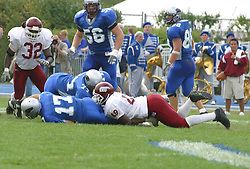 12 October 2002: Tony Romo gets halted by Chad Dewberry.  Eastern Illinois University Panthers host and defeat the Colonels of Eastern Kentucky during EIU's Homecoming at Charleston Illinois.