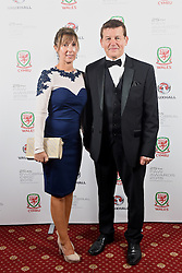 CARDIFF, WALES - Monday, October 5, 2015: Nigel Day and wife during the FAW Awards Dinner at Cardiff City Hall. (Pic by Pete Thomas/Propaganda)