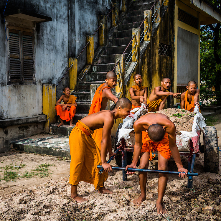 Monks work together to move dirt around at a Khmer monestary near Chau Doc, Vietnam, near the border with Cambodia.